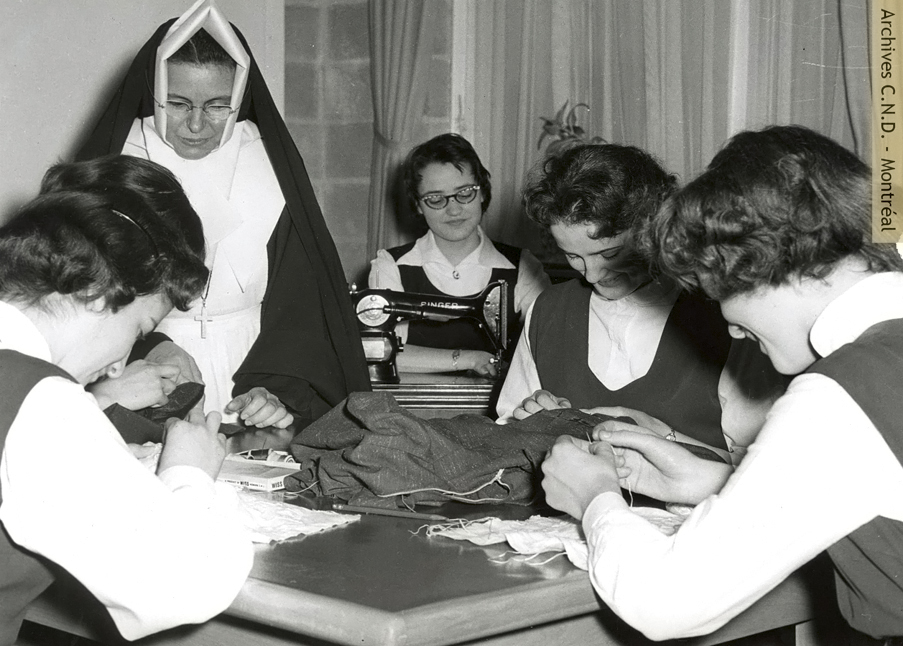 Sewing course with Sister Sainte-Yvonne-des-Anges (Yvonne Paquet) at école Notre-Dame