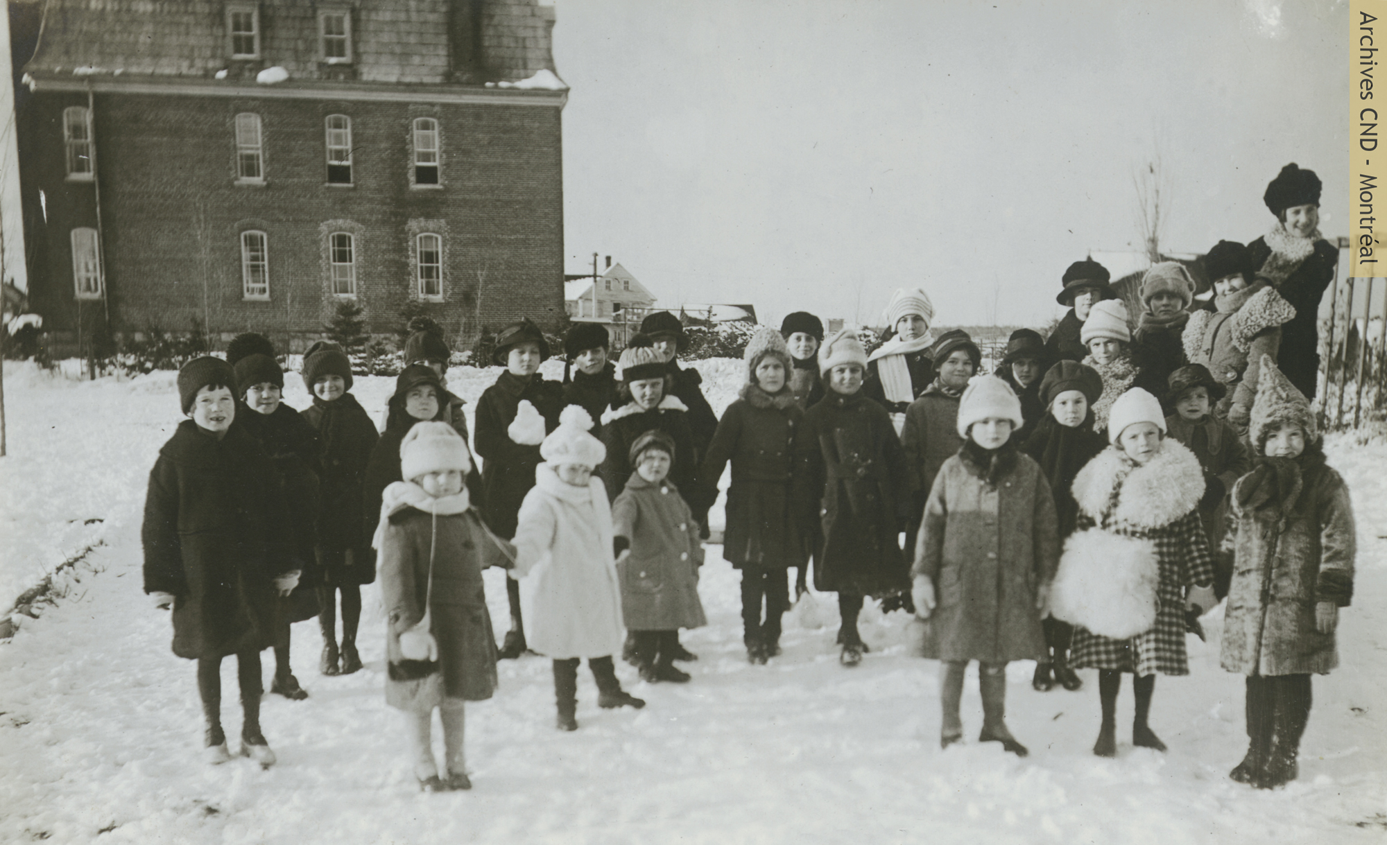 Students of the small boarding school in the yard of Mont Sainte-Agnès