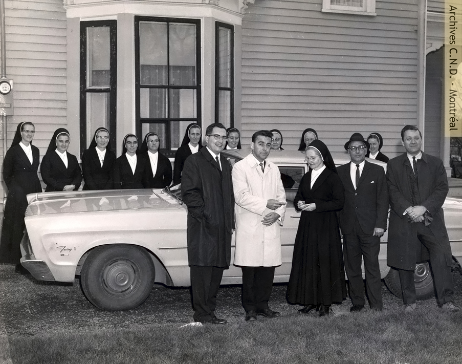The first car of the Sisters of Holy Name Convent, given to them by the parishioners